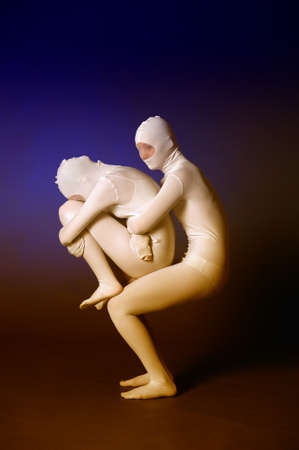 two abstract figures dancing in a white photo