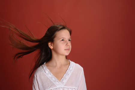 The girl with a flying hair studio Stock Photo - 12665604