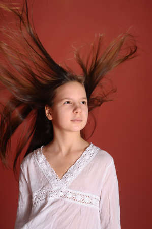 The girl with a flying hair studio Stock Photo - 12665506