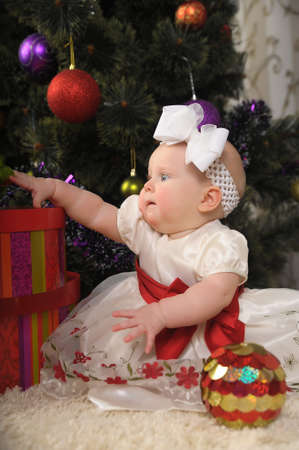 little girl with Christmas ball photo