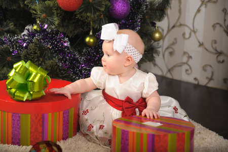 Little girl opening gift box  photo