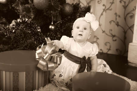 Little girl opening gift box  Stock Photo - 17167078