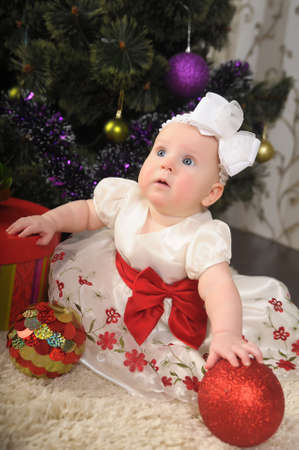 little girl with Christmas balls photo
