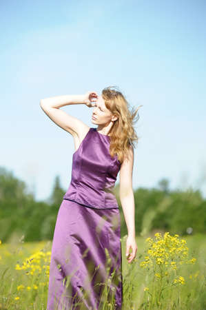 young woman in a field of yellow flowers Stock Photo - 12234580