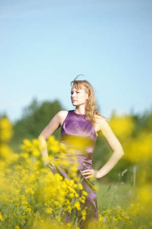 young woman in a field of yellow flowers Stock Photo - 12234519