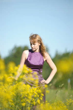young woman in a field of yellow flowers Stock Photo - 12234525