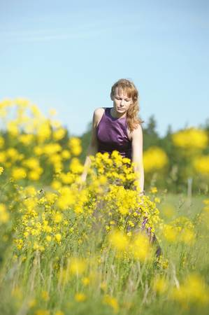 young woman in a field of yellow flowers Stock Photo - 12234577