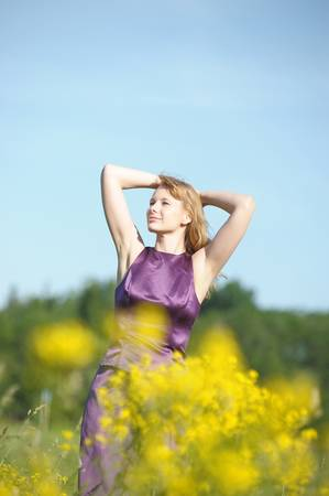 young woman in a field of yellow flowers Stock Photo - 12234506