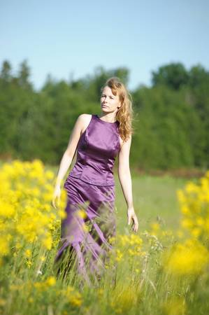 young woman in a field of yellow flowers Stock Photo - 12234576