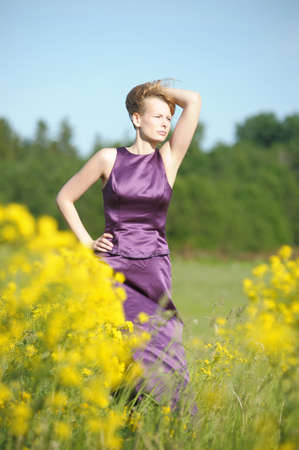 young woman in a field of yellow flowers Stock Photo - 12234517