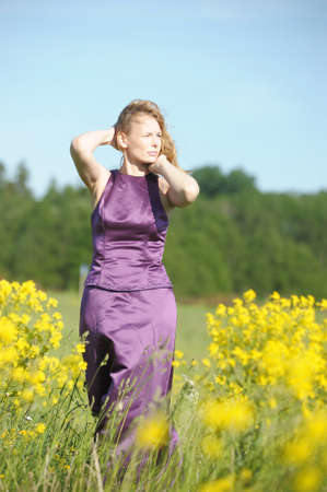 young woman in a field of yellow flowers Stock Photo - 12234581