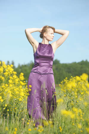 young woman in a field of yellow flowers Stock Photo - 12234541