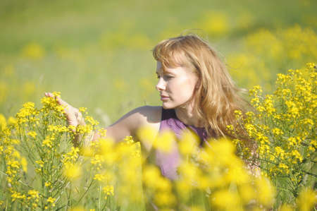 young woman in a field of yellow flowers Stock Photo - 12234562