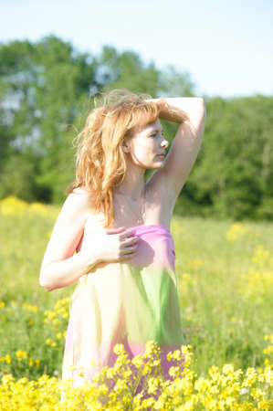 young woman in a field of yellow flowers photo