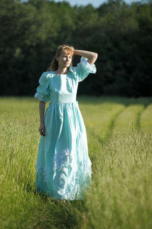 young woman in an retro dress in the field Stock Photo - 12234573