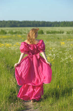 woman in a pink retro a dress photo