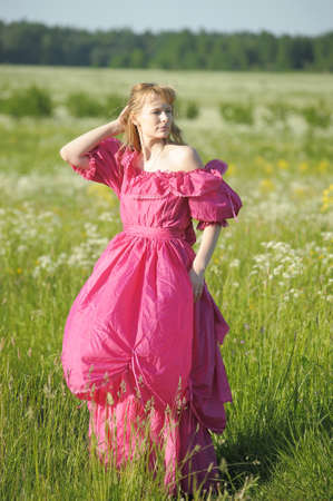 young woman in an retro dress in the field Stock Photo - 12234550
