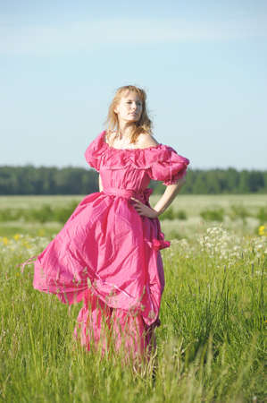 young woman in an retro dress in the field Stock Photo - 12234555