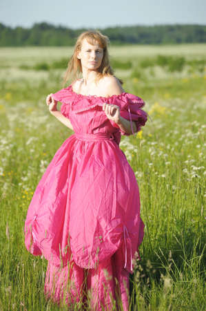 young woman in an retro dress in the field photo