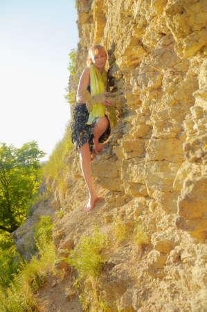 girl on the rock wall otvestnoy photo
