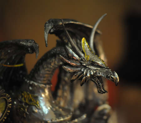 sculpted: statuette of a dragon Stock Photo