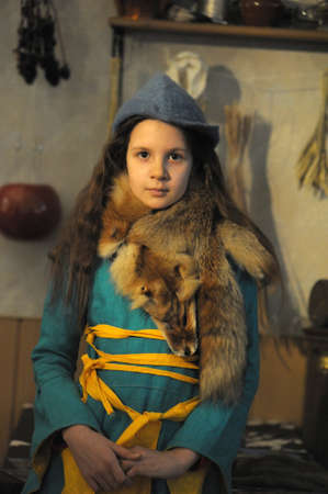 The girl in a medieval suit of the townswoman photo