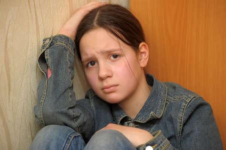 Het meisje van de tiener in een depressie
