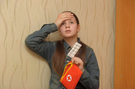 The girl the teenager with a headache Stock Photo - 12387124
