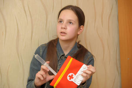 depressant: The girl the teenager with tablets and a syringe in hands