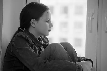 The sad girl the teenager at home on a window sill Stock Photo - 12443029