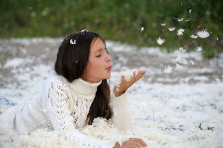 Young beautiful girl filled up by small feathers Stock Photo - 12986811