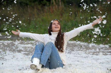 Young beautiful girl filled up by small feathers Stock Photo - 13057064