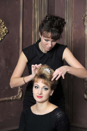 Hairdresser makes hairstyle for young pretty women Stock Photo - 21065362