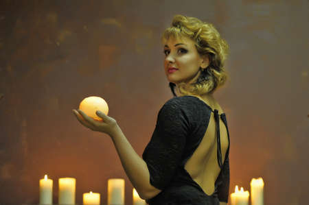 Studio picture of a young woman with candles  photo