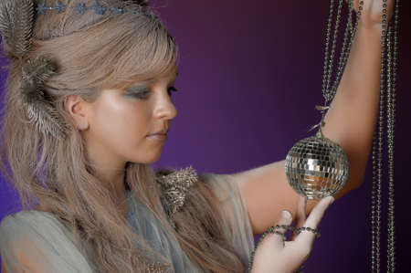 portrait of a girl with a mirror ball in his hands Stock Photo - 14166379
