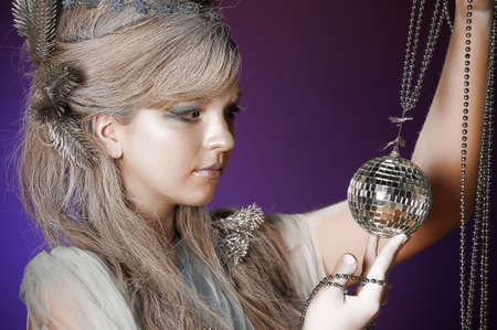 portrait of a girl with a mirror ball in his hands Stock Photo - 14166357
