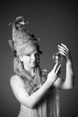 portrait of a girl with a mirror ball in his hands Stock Photo - 14166586