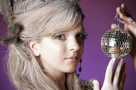 portrait of a girl with a mirror ball in his hands Stock Photo - 14166589