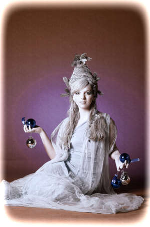 woman hanging toy: girl with a New Year s balls Stock Photo