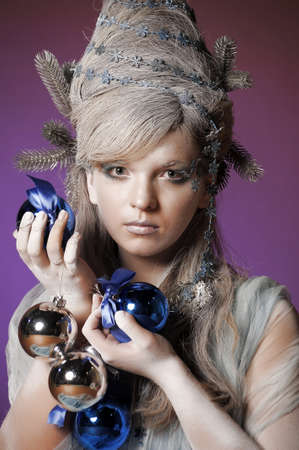 girl with a New Year s balls Stock Photo - 14166100