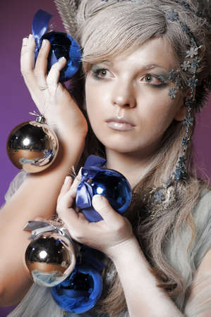 girl with a New Year s balls Stock Photo - 14166414