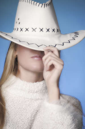Girl wearing cowboy hat in the studio photo