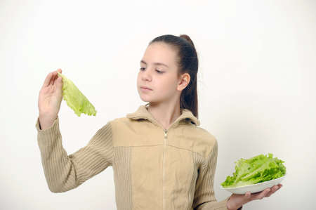 Young beauty girl with green lettuce   photo