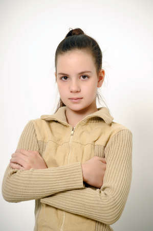 long tail: teen girl with folded arms Stock Photo