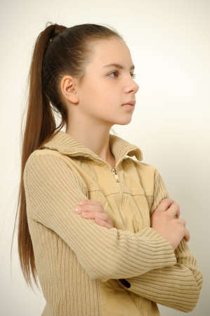 teen girl with folded arms photo