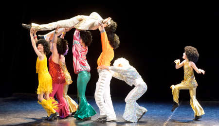 Dance group performs on stage