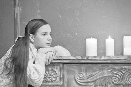 The girl the teenager at a fireplace with candles Stock Photo - 12414307