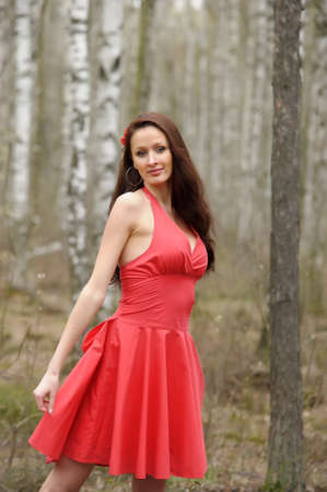 Beautiful woman in the forest photo