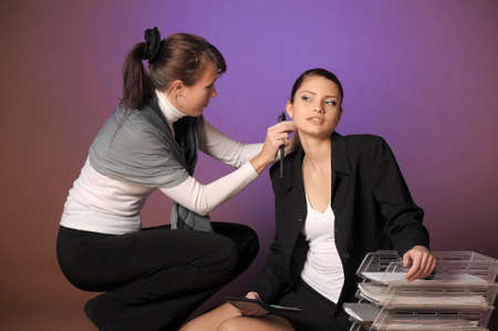 the stylist corrects models a hairdress in studio before shooting Stock Photo - 13252655