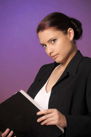 Young secretary or businesswoman in suit with notebook  Stock Photo - 12442968